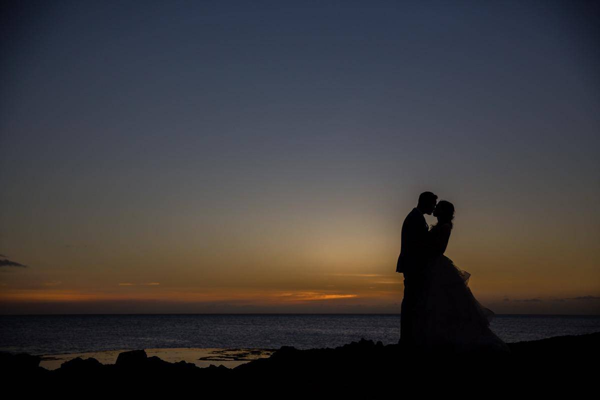 bride and groom silhoutte sunset Oahu Hawaii Destination wedding photographer www.benandhopeweddings.com.au