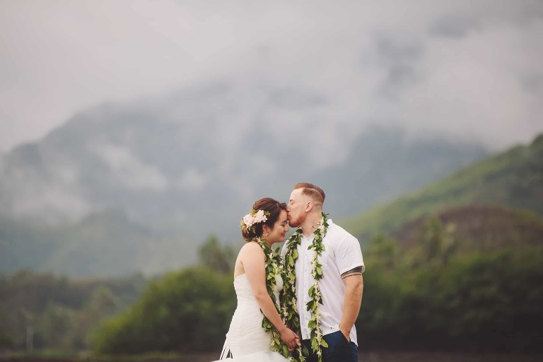 kualoa ranch north shore wedding photography japanese bride local groom kissing in front of mountains www.benandhopeweddings.com.au