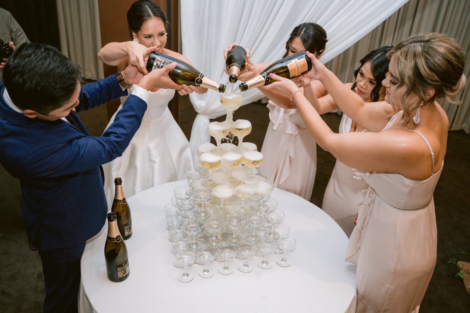 Victoria Park wedding photographer champagne tower bridal party reception details