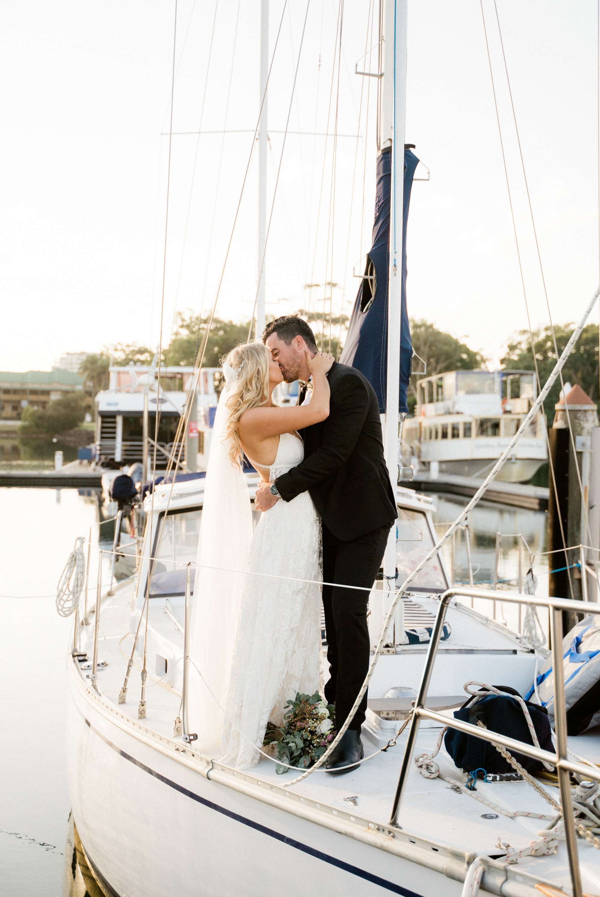 bride and groom on a boat wedding gold coast www.benandhopeweddings.com.au